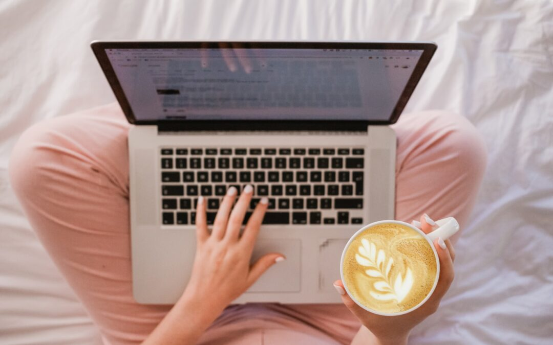 Laptop, coffee in bed